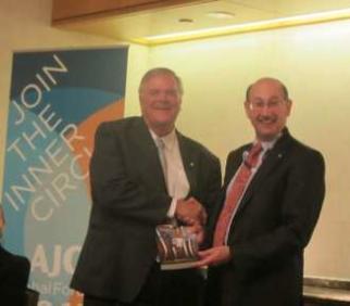 Jeremy Jones AM giving the Cooper book to the Australian Ambassador to USA Kim Beazley June 13