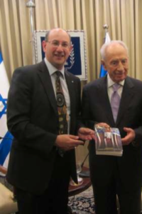 Jeremy Jones AM giving the Cooper book to President of Israel Shimon Peres May 2013